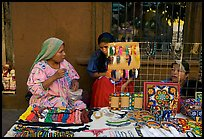 Huichol women selling crafts on the street, Tlaquepaque. Jalisco, Mexico