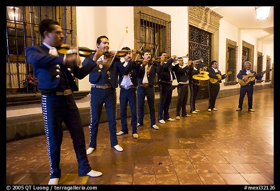 Band of mariachi musicians at night, Tlaquepaque. Jalisco, Mexico (color)