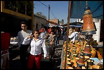 People strolling iin the sunday town-wide arts and crafts market, Tonala. Jalisco, Mexico (color)