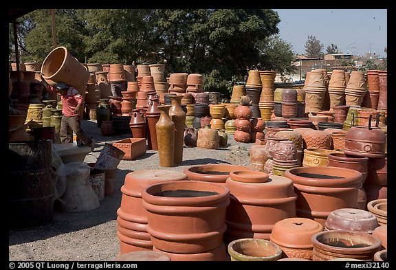 Pots for sale, with a man loading in the background, Tonala. Jalisco, Mexico (color)