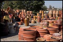 Pots for sale, with a man loading in the background, Tonala. Jalisco, Mexico ( color)