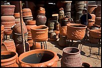 Boy standing next to clay pots, Tonala. Jalisco, Mexico (color)