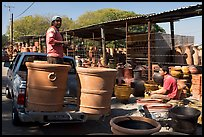Pots being loaded on the back of a pick-up truck, Tonala. Jalisco, Mexico (color)