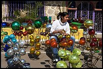 Woman polishing glass spheres, Tonala. Jalisco, Mexico (color)
