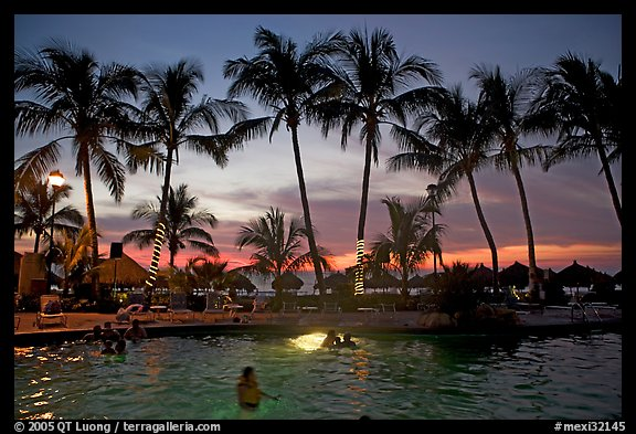 Palm-tree fringed swimming pool at sunset, Nuevo Vallarta, Nayarit. Jalisco, Mexico