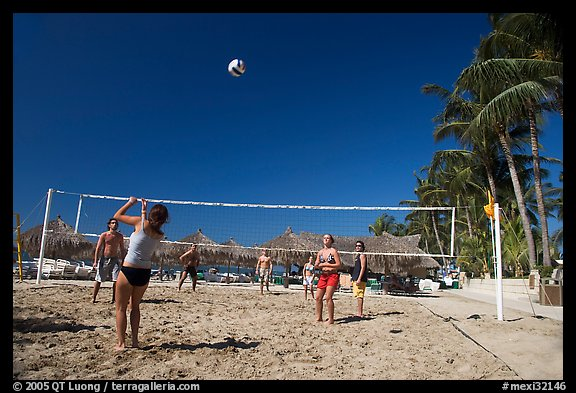 Vacationers playing beach volley-ball, Nuevo Vallarta, Nayarit. Jalisco, Mexico (color)