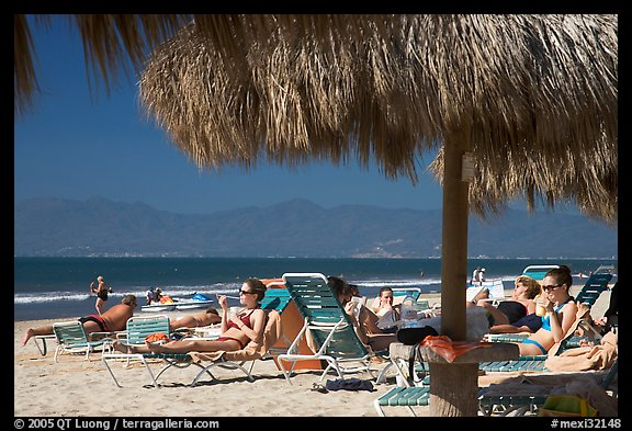 People lying on beach chairs, Nuevo Vallarta, Nayarit. Jalisco, Mexico