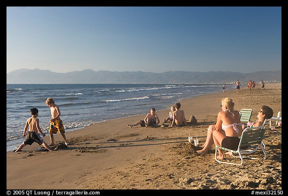Mothers sitting on beach chairs watching children play in sand, Nuevo Vallarta, Nayarit. Jalisco, Mexico (color)