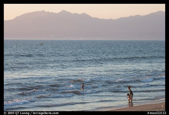 Woman holding children on the beach at sunset, Nuevo Vallarta, Nayarit. Jalisco, Mexico (color)