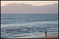 Woman holding children on the beach at sunset, Nuevo Vallarta, Nayarit. Jalisco, Mexico ( color)