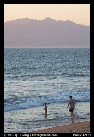 Man and child on the beach at sunset, Nuevo Vallarta, Nayarit. Jalisco, Mexico (color)