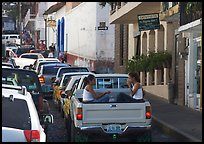Young women riding in the back of a pick-up truck in a busy street, Puerto Vallarta, Jalisco. Jalisco, Mexico (color)