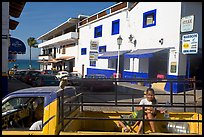 Girl riding in the back of pick-up truck in a street close to ocean, Puerto Vallarta, Jalisco. Jalisco, Mexico (color)
