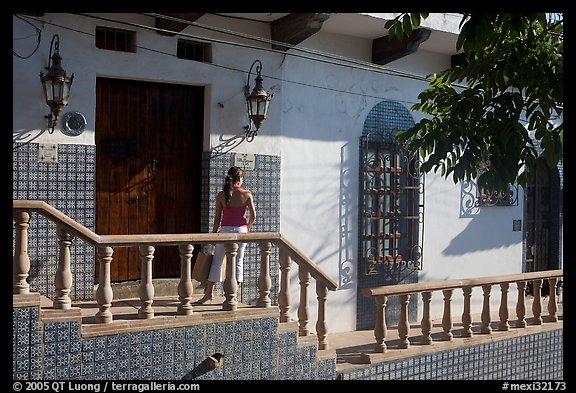 Woman waiting at the door of a house, Puerto Vallarta, Jalisco. Jalisco, Mexico