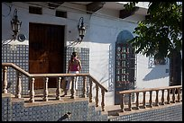 Woman waiting at the door of a house, Puerto Vallarta, Jalisco. Jalisco, Mexico (color)