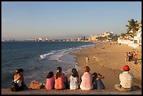 Family sitting above the beach, late afternoon, Puerto Vallarta, Jalisco. Jalisco, Mexico (color)