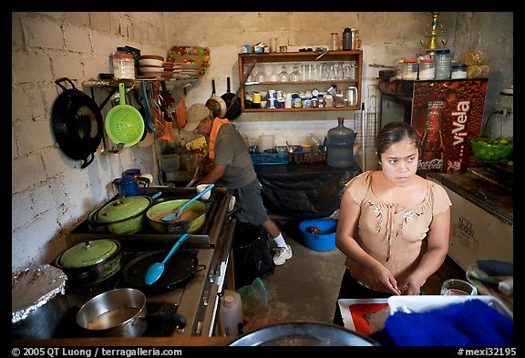 Woman and man in a restaurant kitchen, Jalisco. Jalisco, Mexico (color)