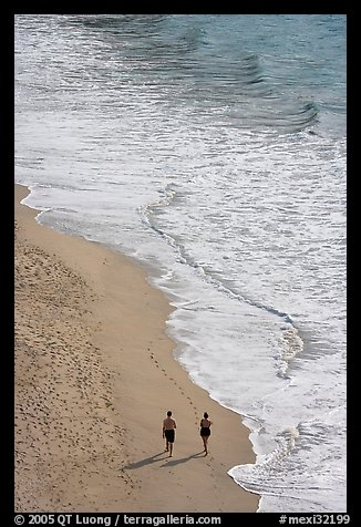 Couple walking on the beach seen from above, Puerto Vallarta, Jalisco. Jalisco, Mexico (color)