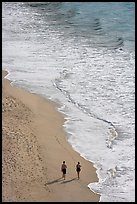 Couple walking on the beach seen from above, Puerto Vallarta, Jalisco. Jalisco, Mexico ( color)