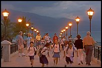 Children running on footbridge above Rio Cuale at dusk, Puerto Vallarta, Jalisco. Jalisco, Mexico