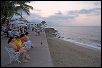 Women sitting on a bench looking at the ocean, Puerto Vallarta, Jalisco. Jalisco, Mexico (color)