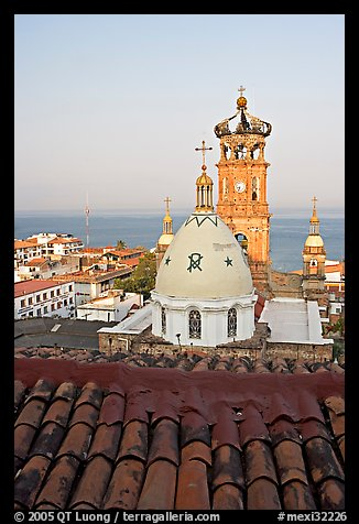 Red tile roof, Templo de Guadalupe Cathedral, and ocean early morning, Puerto Vallarta, Jalisco. Jalisco, Mexico (color)