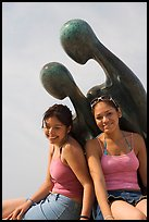 Women sitting on the sculpture called Nostalgia, Puerto Vallarta, Jalisco. Jalisco, Mexico