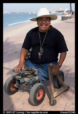 Man without legs  smiling on the Malecon, Puerto Vallarta, Jalisco. Jalisco, Mexico (color)