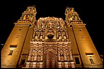 Illuminated facade of Cathdedral laced with Churrigueresque carvings at night. Zacatecas, Mexico