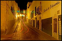 Uphill paved street by night with light trail. Zacatecas, Mexico