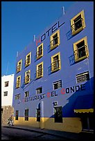 Hotel restaurant building painted bright blue and yellow. Guanajuato, Mexico ( color)