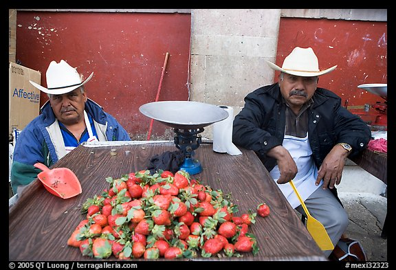 Men with cow-boy hats selling strawberries. Guanajuato, Mexico (color)