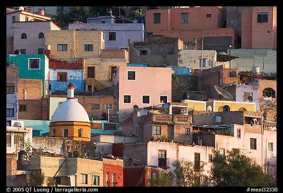 Multicolored houses on a steep hillside, late afternoon. Guanajuato, Mexico (color)
