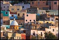 Multicolored houses on a steep hillside, late afternoon. Guanajuato, Mexico