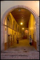 Man walking in an arched passage a dawn. Guanajuato, Mexico