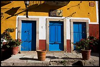 Blue doors and yellow wall on Plaza San Roque. Guanajuato, Mexico