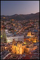 Panoramic view of the historic town with illuminated basilic, university, and La Compania. Guanajuato, Mexico (color)