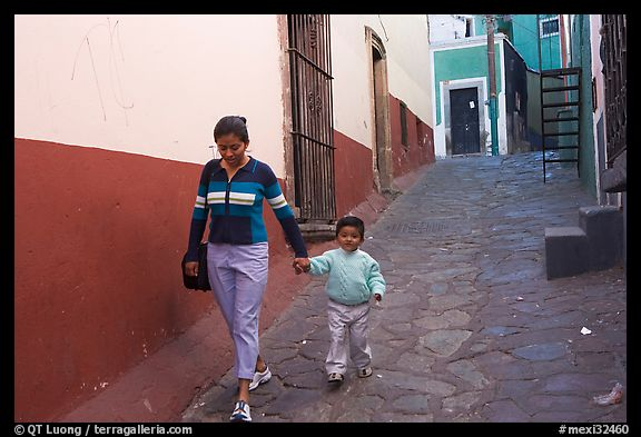 Woman and boy walking down an alleyway. Guanajuato, Mexico (color)