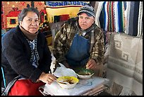Couple eating in the street. Guanajuato, Mexico (color)