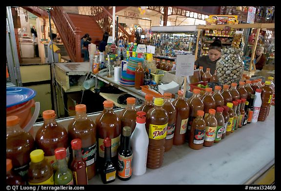 Chili bottles at a booth in Mercado Hidalgo. Guanajuato, Mexico (color)