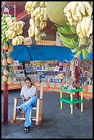 Woman sitting in a fruit stand. Mexico ( color)