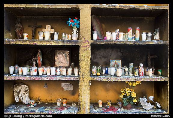 Candles in a roadside chapel. Mexico (color)