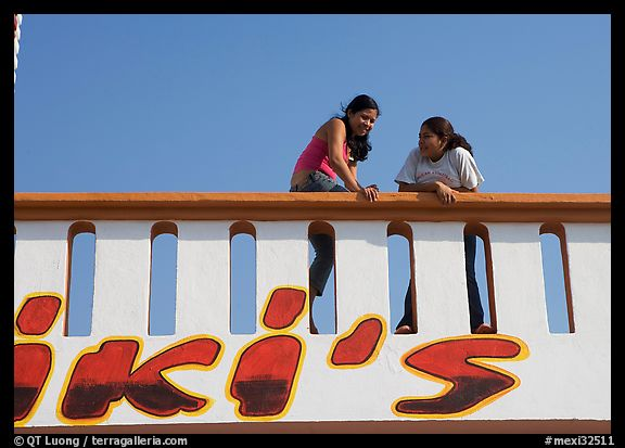 Young women sitting on a roof. Mexico (color)
