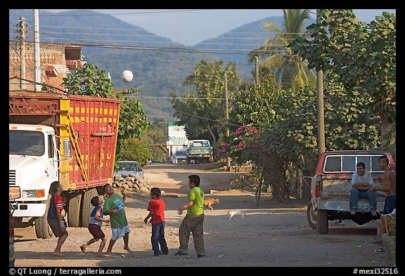 Children playing with a ball in village street. Mexico (color)