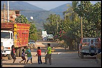 Children playing with a ball in village street. Mexico