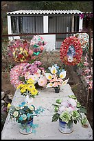 Multicolored flowers on a grave. Mexico (color)