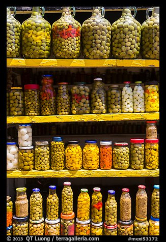 Jars of preserved pickles. Baja California, Mexico (color)