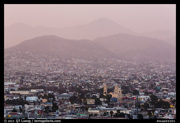 Distant view of Ensendada spreading up hills at sunset. Baja California, Mexico (color)
