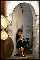 Girl in a doorway. Jerusalem, Israel