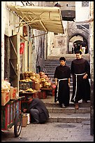 Two christian monks in a narrow alley. Jerusalem, Israel